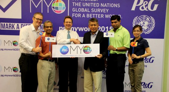 UN officials and P&G executives pose for a picture after the MY World launch event in Bangkok.