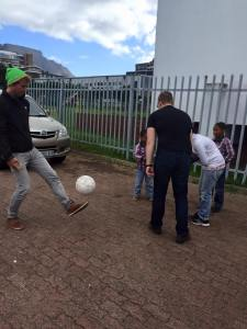 Jilt & Jonas playing futbol with some kids at the women's center