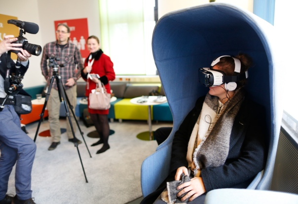 Journalists experience United Nations Virtual Reality (unvr.org) at the Global Campaign Center of the UN SDG Action Campaign in Bonn. UNVR shows the human story behind development challenges, allowing people with the power to make a difference have a deeper understanding of their world. 15 December 2016. photothek / Ina Fassbender